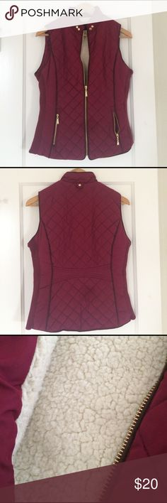 Stylish, cozy vest This vest is very flattering and warm! Excellent details from quilted stitching, dark brown piping, and gold accents. Rich burgundy/wine color. Perfect condition. Jackets & Coats Vests