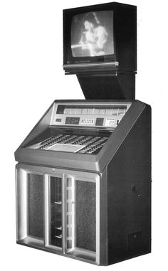 1986, Rowe-AMI's Model R-90: Sapphire or Golden... this one with the Video\ Music Entertainment Center. [Jukebox Collector]