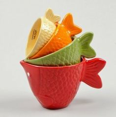 Ceramic Fish Measuring Cup - 4 Pc Set by Kitchen Corner. $29.99. Hand wash. Ceramic. Imported. Dimensions: 1/4 cup, 1/2 cup, 3/4 cup, 1 cup. Go aquatic in the kitchen with a set of measuring cups that blows all the others out the water! Perfectly crafted from ceramic with textured scaled and fins, this 4-piece set will add finesse to any kitchen shelf with its eye-catching colors and creative design.