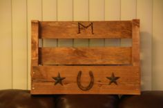 Wine rack my husband made...even branded an 'M' into it!