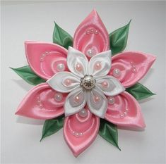 Kanzashi flower– just a petal tutorial.  In Russian, but the pictures are easy to follow