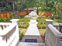 This landscape design is more of a continental style garden that incorporates English garden elements of a rose parterre and folly with the elegance of a travertine terrace and balustrade.