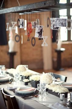 Suspend a ladder above the table and hang photos of family and friends for a conversation starting centerpiece