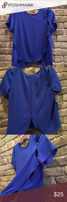 NWT Royal Blue Slitted Top NWT! Light weight polyester. Slits in the side and through shoulder as well as middle back. Royal Blue Lovely Day Tops Tees - Short Sleeve
