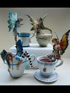 Amy Brown: Fairy Art - The Official Gallery Fairy teacups!The coffee/tea/cocoa figurines are back in stock. Just to be clear, these are hand painted resin figurines for decorative purposes, not actual cups. Amy Brown fairies, lower left, too good. Amy Brown Fairies, Dark Fairies, Fairy Figurines, Paperclay, Fairy Art, Fairy Dolls, Handmade Decorations, Table Decorations, Faeries