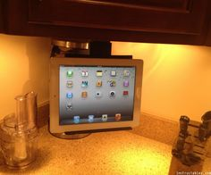 Under Cabinet iPad / Tablet mount. Look Swenson Ipad Mount, Tablet Mount, Ipad Tablet, Tv In Kitchen, Kitchen Cabinets, Kitchen Ideas, Under Cabinet Tv, Recipe Holder, Ipad Holder