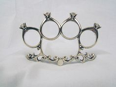 Epic wedding ring/self defense weapon. I'd marry the man who gave my this, and then make him get me something else. lol
