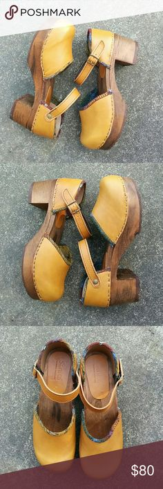Sanita clogs Like new and amazing, Sanita wooden clogs! Overall excellent condition. Genuine leather uppers are a stunning shade of mustard. These were a recent purchase that I just feel doesn't go with as much in my closet as I had hoped. Size 37, runs about half size big. Sanita Shoes Mules & Clogs