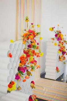 rainbow neon wedding backdrop with bright bold flowers