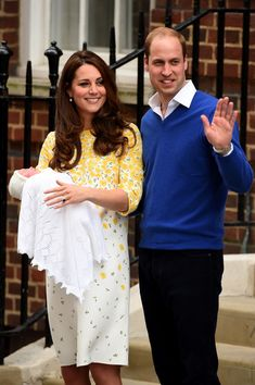 Catherine, Duchess of Cambridge and Prince William, Duke of Cambridge leave The Lindo Wing of St Mary's Hospital with their newborn daughter, Charlotte Elizabeth Diana,  on May 2, 2015 in London, England.  Jenny Packham dress.