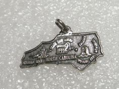 "Vintage Sterling Silver North Carolina  Charm or Pendant, 1.79 grams, 1"" wide #pictogramofnativeamericankachinaonside #charmorpendant"