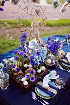 alice in wonderland themed wedding centerpieces  maybe with something crystal or floral instead of just branches