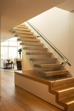 "floating stair by Powell and Bonnell . interesing concept for ""base of stairs""- good storage space"