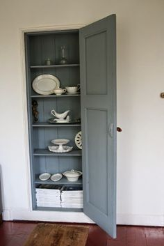 Love this built in shallow cupboard ( looks like it's between the studs) for our dining area near the doors and living room.