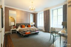 We live for this unexpected punch or orange in this sea of textured greys in Fredrik Eklund's $9.9 Million Apthorp listing in Manhattan!