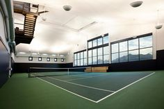 Photograph of an indoor tennis court.