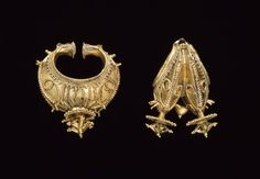 Bengal (probably Orissa or Assam) | Elaborate gold filigree earrings. The ear ornaments are made from hollow sheet gold with applied chased, twisted and plain wire, granulation and other decoration. | ca. mid 19th century