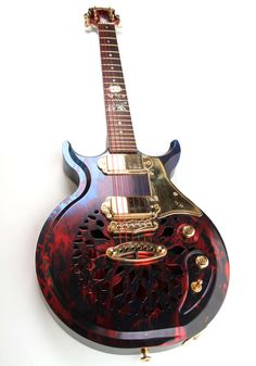 """voodoo haze"" all aluminum double cutaway with resonator style cutouts."