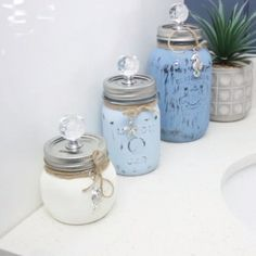 Mason Jar Crafts 34902965850564822 - Make your own mason jar canisters! This mason jar canister set is perfect for your kitchen or bathroom, and can be customized to your own decor. Source by amandaformaro Mason Jar Projects, Mason Jar Crafts, Mason Jar Diy, Bottle Crafts, Diy Crafts Vases, Mason Jar Shelf, Uses For Mason Jars, Mason Jar Sconce, Fun Crafts