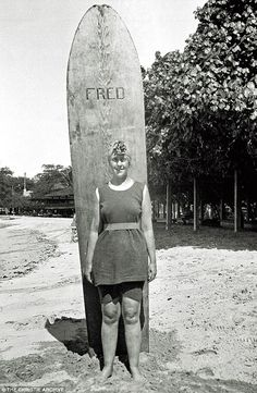 The Queen of Crime Agatha Christie stands on Muizenberg Beach, South Africa, following surf bathing, 1922.
