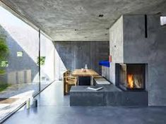 Coarse concrete walls encase this house by Wespi de Meuron Romeo Architetti, which overlooks Switzerland's Lake Maggiore from a wooded site sunken down below street level. Concrete Bench, Concrete Houses, Concrete Blocks, Concrete Walls, Concrete Fireplace, Casa Bunker, Bunker Home, Architecture Design, Contemporary Architecture