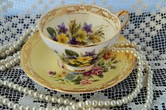 An absolutely fabulous vintage highly decorative antique Royal Sutherland 'cabinet' set of cup and saucer. Priced per cup and saucer. c1940s