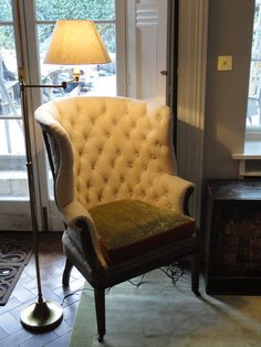 Wingchair with buttoned back, deconstructed style.