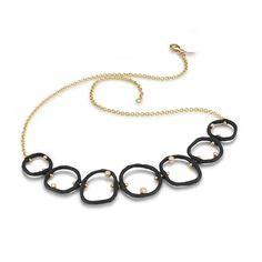 Matte black oxidized cobalt chrome circles with diamonds at Manika Jewelry San Francisco