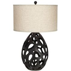 The warm color in the drum shade offsets the ultra-modern look of this black table lamp. The matte finish highlights the openwork base that allows light to shine through for a beautiful effect. Ideal for contemporary decor. Black Table Lamps, Metal Table Lamps, Modern Farmhouse Table, Metal Grid, Pacific Coast, Drum Shade, Contemporary Decor, Warm Colors, Matte Black