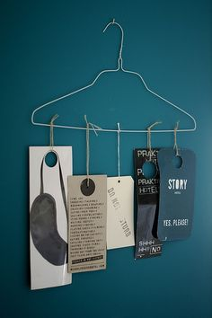 You can hang all sorts of interesting things the way these tags are hung on a white hanger.