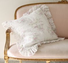 Beauitful floral and pink pillows.