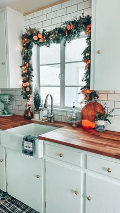 Christmas Garland, Tree and Other Holiday Décor in our Bungalow - Blushing Bungalow Christmas Window Decorations, Farmhouse Christmas Decor, Christmas Kitchen, Cozy Christmas, Christmas Stuff, White Christmas, Christmas Time Is Here, Kitchen Decor, Kitchen Stove