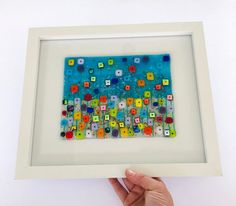 """Rainbow Riot 2Handmade fused glass unique multicoloured floral framed wall art. Size 33cm x 28cm including frame. """"Rainbow Riot""""Made by me """"Kirstyn"""" aka Cornish fused glass in my studio here in the middle of Cornwall. Growing up and living in Cornwall I have always had the pleasure of many day trips to our beautiful beach's, glorious woods and moors. I am very much inspired by all of these stunning places when it comes to creating my fused glass art. The colours in this artwork are a… Frames On Wall, Framed Wall Art, Glass Christmas Decorations, Bullseye Glass, Rainbow Flowers, Gifts For My Sister, Fused Glass Art, Glass Flowers, Cornwall"""