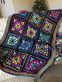 A popular crochet pattern gets a unique look! Each 14 square was meticulously color designed to achieve a true cathedral - like glow. Over 200 hours will be spent creating this masterpiece. It measures 40×70, a perfect cover for a twin bed, draping over a sofa, or the perfect bedding for your guest room! It is 100% acrylic, machine washable AND low heat dryer friendly.