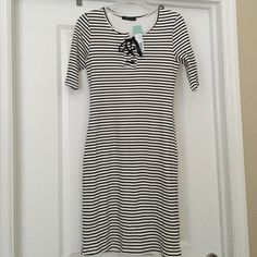 Sandee dress, black and white striped dress Sander dress, black and white striped dress with fun lace up detail at the neck. Would be super cute with black tights, boots, and black leather jacket ! Size M, never been worn. Has attached slip underneath. Hailey 23 Dresses Midi
