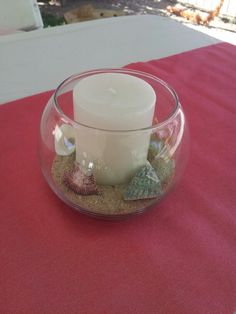 Luau theme decoration - Dollar store candles, dollar store vases & a bag of seashells