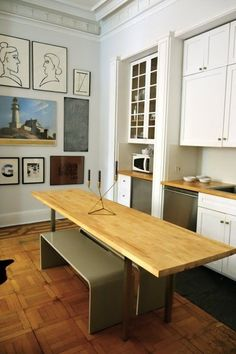 If your space is slightly less tiny, use a long and narrow butcher block that doubles as counter space and dinner party table.