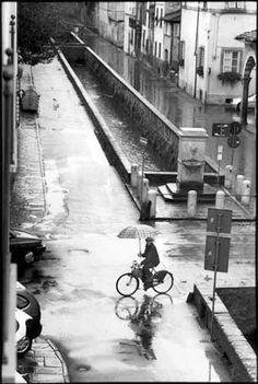 by Richard Bram [man, bicycle, umbrella]