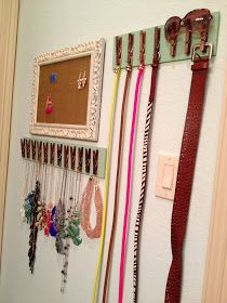 Glue some clothespins or use screw hooks on a strip of wood for a creative way to organize belts and necklaces. You could also use the clothes pins to hang a small box or basket for chunky bracelets or other items that wont fit the clothespins.