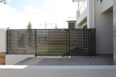 Slat Fencing Perth. Contact Simply Slat Fencing for Timber Effect Aluminium Slats, Powder Coated Aluminium Slats, Slat Gates, Automated Gates and more