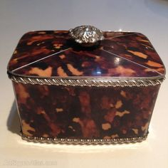 """Faux Tortoiseshell Tea Caddy // Very pretty, Victorian faux Tortoiseshell tea caddy (c1860-1880). White metal decorative edging and handle and internal lining with two internal divisions.   5"""" Wide x 3"""" High //  Price £360.00"""