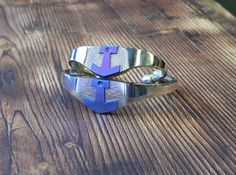 Stainless steel bracelets with anodized titanium anchors inlays.