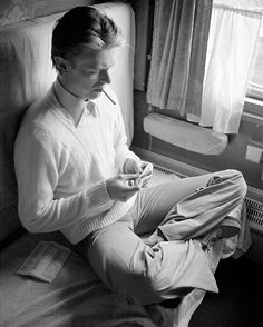 David Bowie passing time on a train bound for the Soviet Union, April 1976. Photo by Andrew Kent.