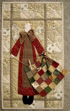 "The pattern is called ""Quilter's Angel""  She was designed by Terry Morberg. www.applepatchdesigns.com"