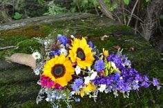 Melanie in Indianapolis, IN  - Gillespie Florists Sunflowers, delphinium, aster, daisies, waxflower and limonium