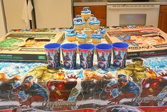 Fun family night activity! Avengers party with avengers comic books, activity books, cups, masks, etc.