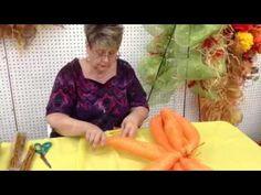 How to make a pumpkin out of deco mesh ribbon - YouTube  http://www.youtube.com/watch?v=PyTy9fAX6_8