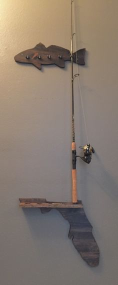 A personal favorite from my Etsy shop https://www.etsy.com/listing/254116321/fishing-rod-wall-mount-holder-5-clip