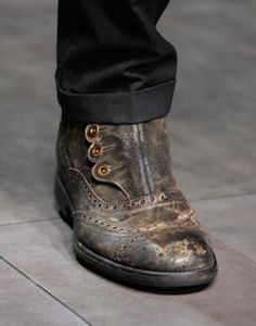 Really interesting take on the Monk Shoe in a Brogue - no lacing, closed by side buttons (as opposed to the conventional buckle) by Dolce & Gabbana - Fall 2012 collection (photo by Alessandro Viero)