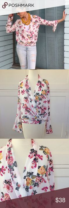 Blush Pink Bell-Sleeve Floral Top PRICE FIRM. NO TRADES. It's all about blush pink, florals and bell sleeves! Gorgeous drape-front top. No closures. Unlined. 100% polyester. Hand wash cold. New with tag. Band at waist does not stretch. Modeling size S in pics. From Bellini. Made in USA. So pretty!!! Cursing Ballerina Tops Blouses